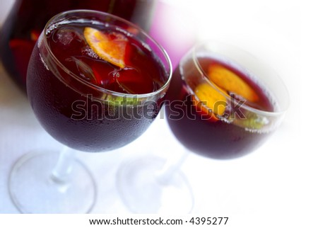 Two glass cups filled with fresh tasty sangria - stock photo