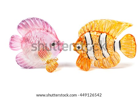 Two glass fish figurines on white background - stock photo