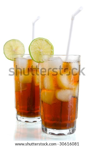 Two glass of ice tea or cola with sliced lime an straws, isolated on white