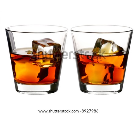 two glass of whiskey with ice cubes on white background - stock photo