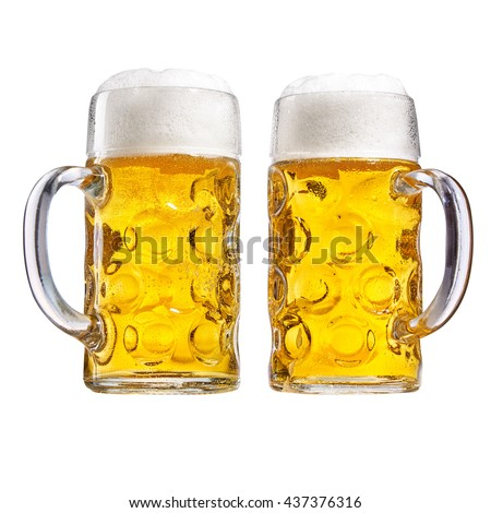 Two glass tankards of chilled beer with a good frothy head side by side with the handles in opposite directions isolated on white conceptual of the Oktoberfest