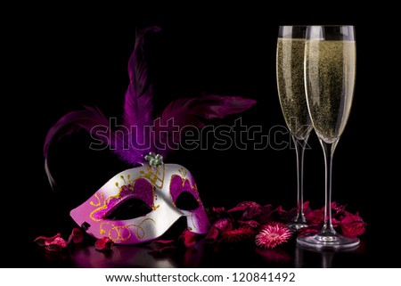 two glass with champagne on a wooden table - stock photo