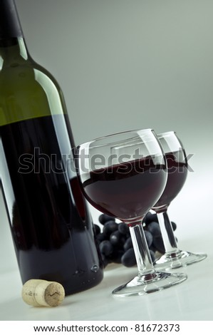 Two glasses and a bottle of red wine - stock photo