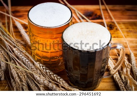 two glasses brown golden beer golden red background holiday Valentine Day event luxury life drink night ale foam wooden table pint russian kvass brew. Rustic style - stock photo