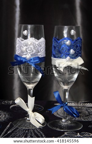Two glasses decorated with flowers for a wedding reception in blue tones - stock photo