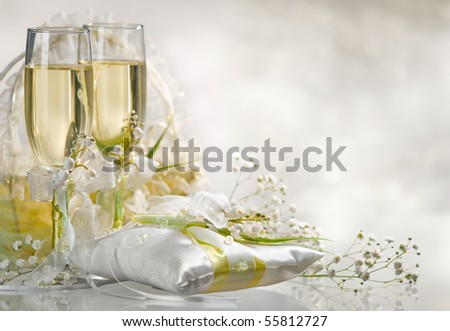 Two glasses filled with  champagne  with flowers - stock photo