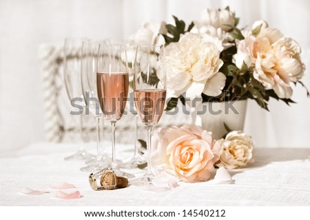 Two glasses filled with pink Champagne with flowers /Vintage style - stock photo