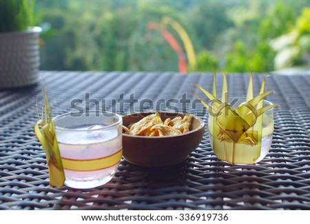 Two glasses of beverage and snack on the table - stock photo