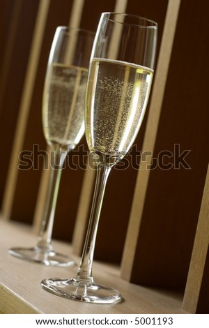 two glasses of champagne close up shoot - stock photo
