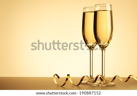 two glasses of champagne on background - stock photo