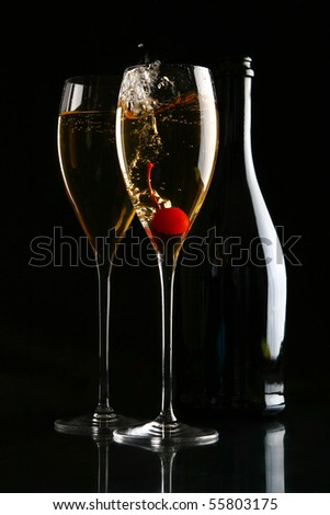 two glasses of champagne on black - stock photo
