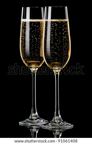 Two glasses of champagne on  black background - stock photo