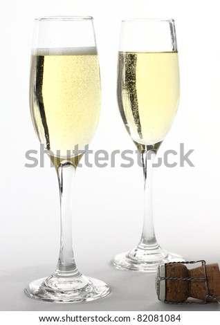 Two glasses of champagne on white backgroundne