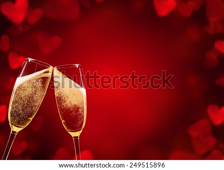 Two glasses of champagne with abstract blur background made of hearts shapes - stock photo