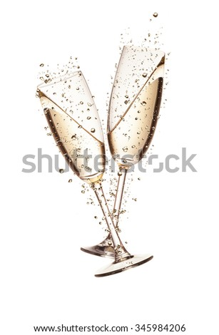 Two glasses of champagne with bubbles, isolated on white background - stock photo