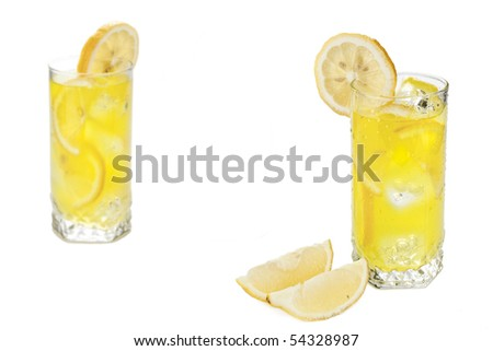 Two glasses of cold beverage with slices of lemon - stock photo