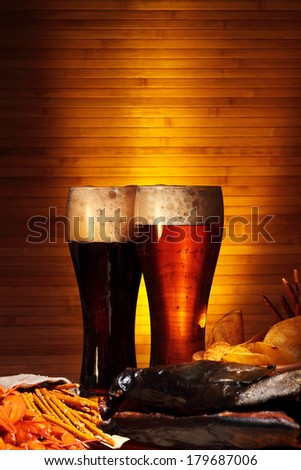 Two glasses of dark and light beer with crawfish - stock photo