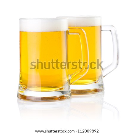 Two glasses of fresh beer with foam isolated on white background - stock photo