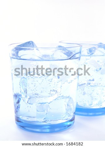 two glasses of mineral water with ice isolated