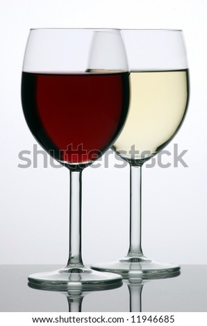 Two glasses of red and white wine - stock photo