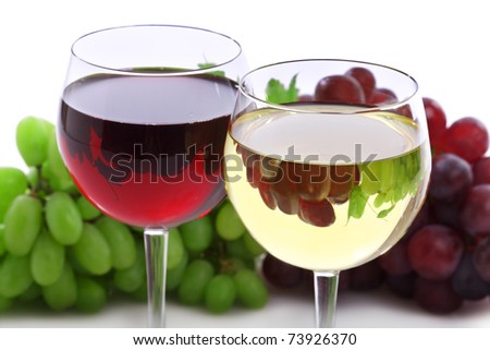 Two glasses of red and white wine with grape reflection