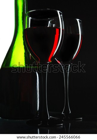 Two glasses of red wine and bottle
