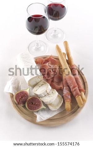 Two glasses of red wine and snacks from the top - stock photo