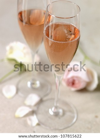 Two glasses of ros�© Champagne and roses - stock photo