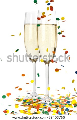 Two glasses of sparkling wine and falling confetti on a white background - stock photo
