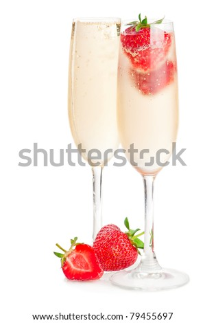 Two glasses of sparkling wine (champagne) and strawberry on white - stock photo
