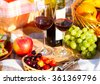 Two glasses of the red wine, picnic theme. Summer time. - stock photo