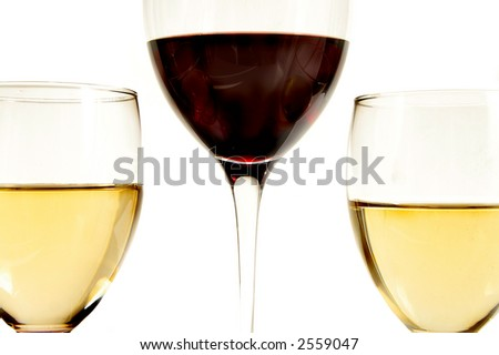 Two glasses of white and glass of red wine closeup, on white