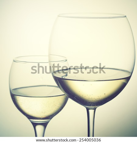 Two glasses of white wine. Instagram style filtred image - stock photo
