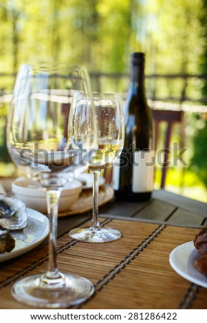Two glasses of white wine on a table - stock photo