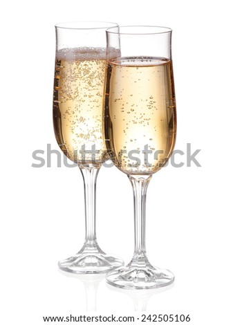 Two glasses with champagne. Isolated on white with clipping path. - stock photo