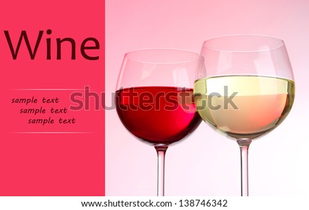 Two glasses with red and white wine isolated on white - stock photo