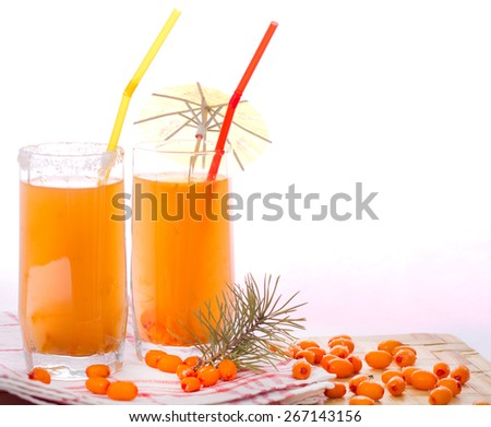 Two glasses with sea buckthorn fruit drink and sea-buckthorn berries - stock photo