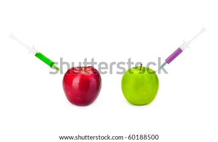 Two GMO apples with syringes on the white