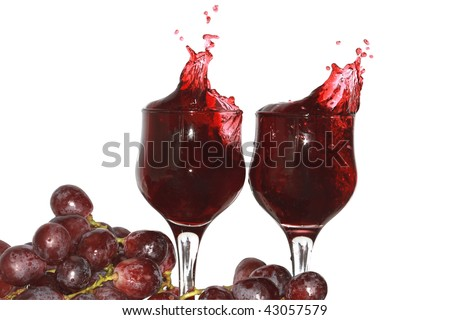 Two goblets of red grape juice and grapes bunch isolated on white with clipping path