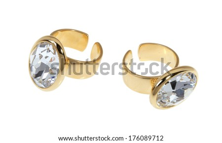 Two gold-plated rings with zircons on a white background.