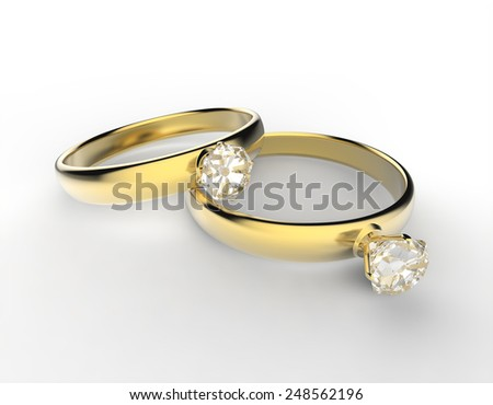 Two gold rings with gemstone - stock photo