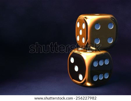 Two golden dice against dark violet background - stock photo