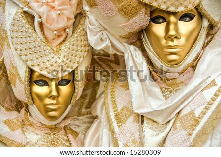 Two golden mask in Venice, Italy. - stock photo