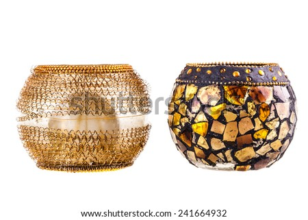 two golden modern candle holders isolated over a white background - stock photo