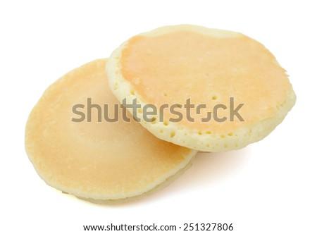 two golden pancakes on white background - stock photo