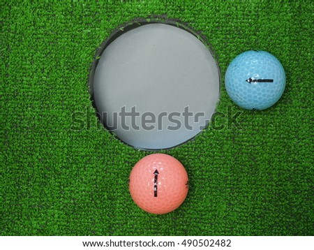 Two golf ball lip at the hole