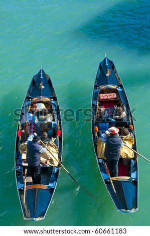 Two gondolas full of people seen from above at Venice, Italy - stock photo