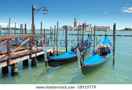 Two gondolas on the San Marco canal and Church of San Giorgio Maggiore in Venice, Italia. - stock photo