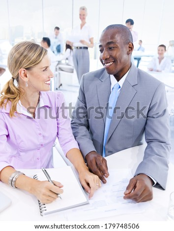 Two Good Looking Diverse Business People Smiling in Office - stock photo