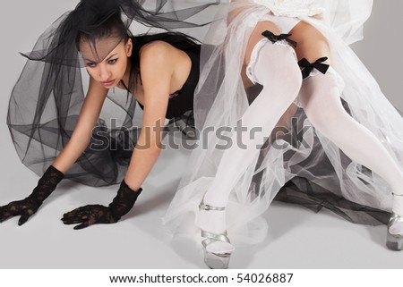 Two gorgeous young models like brides wearing black and white lingerie - stock photo
